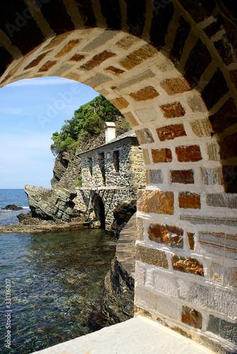 Traditional house on a tropical beach through a cave, Greece