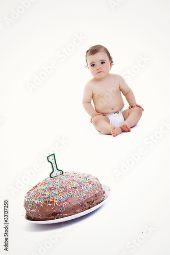 An Adorable One Year Old Girl Enjoying Her First Birthday Cake
