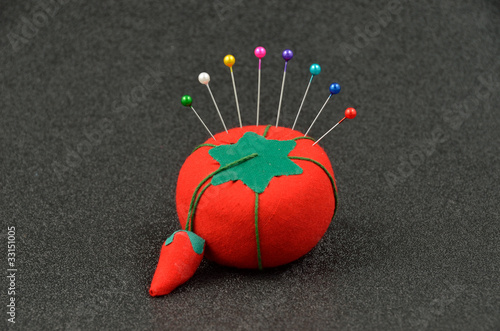 Pin Cushion with Pins - Buy this stock photo and explore