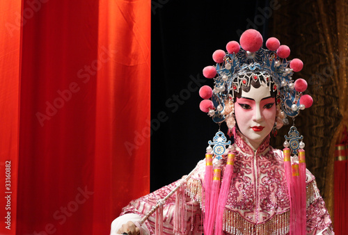 Fotografie, Obraz  chinese opera dummy and red cloth as text space ,it is a toy,not