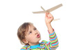 little girl in striped shirt playing with wooden toy plane