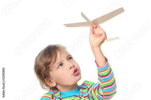 Fotografie, Obraz  little girl in striped shirt playing with wooden toy plane