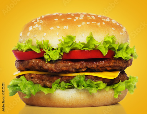 big hamburger on yellow background