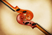 Two Old Violin Scrolls Detail In Ambient Light