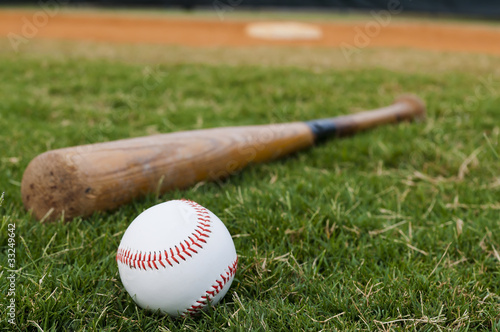 Fotografie, Obraz  Baseball and Bat on Field