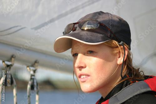 Fotografie, Obraz  Young woman dinghy sailing at regatta