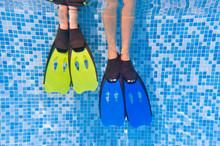 Underwater Kid's Legs In Fins ...