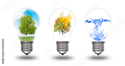Fotografía  Light bulb with three elements inside: nature, fire and water