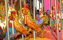 A Fun Fair Carousel Ride With Chickens And Horses.