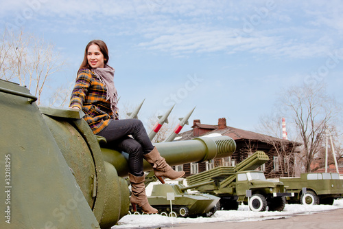 Canvas Prints Fishing woman in a museum of military equipment