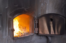 Open Iron Stove In Boiler Room