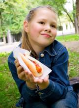 The Beautiful Girl Eats Hot Dog