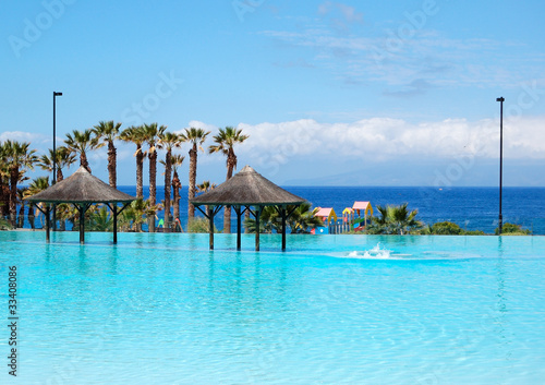 Swimming Pool With Jacuzzi And Beach Of Luxury Hotel Tenerife I