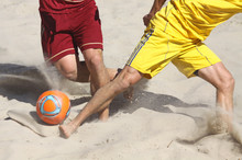 People Playing Soccer On A Beach