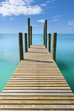 Wooden Jetty Leading In Turquo...