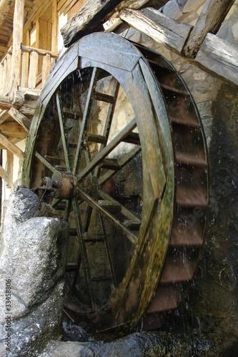 Foto op Plexiglas Molens Water mill wheel