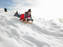 Pre-teen Boy On A Sled In The ...
