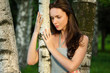 Sad beautiful girl in a birch grove
