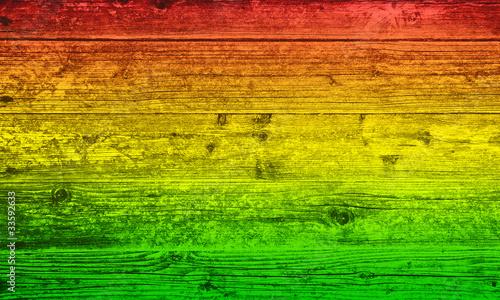 Fotografía Holzbrett Hintergrund in Reggae-Farben