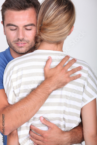 Valokuva  man with closed eyes embracing a blonde