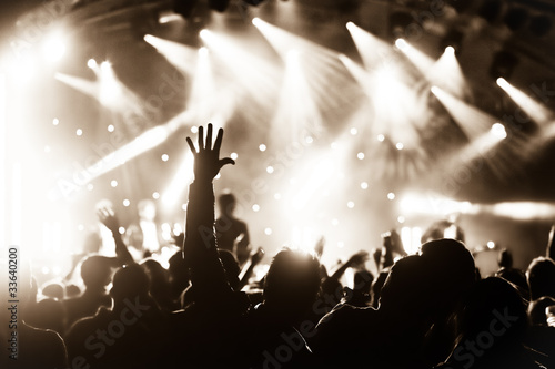 Obraz hands raised by the crowd at a live music concert - fototapety do salonu