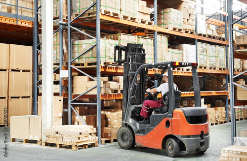 worker driver at warehouse forklift loader works Canvas Print