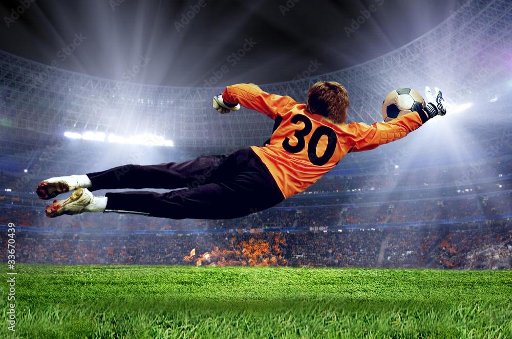 Fototapeta Football goalman on the stadium field
