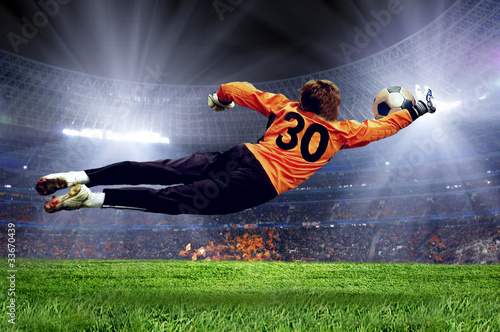 Photo Stands Football Football goalman on the stadium field