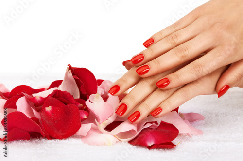 Staande foto Manicure Closeup image of red manicure with leafs of rose