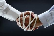 Binding Business Handshake With Rope