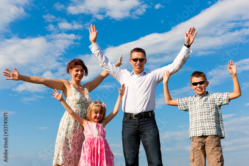 Foto op Canvas Bedehuis Happy family on a medow in summer
