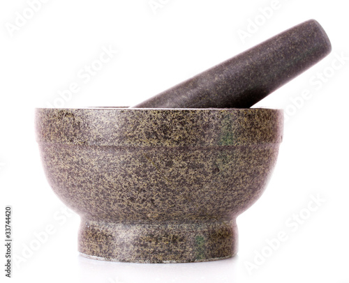 Wallpaper Mural stone pestle and mortar over a white background