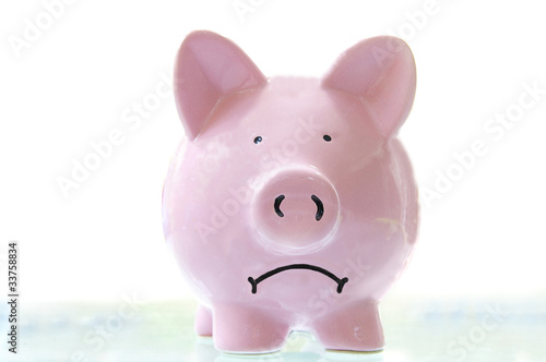 Photo  frowning pink piggy bank, on white