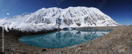 Wall Murals Nepal Tilicho peak reflection in the Tilicho lake, Nepal