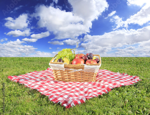 Fotobehang Picknick Picnic at meadow with perfect sky background