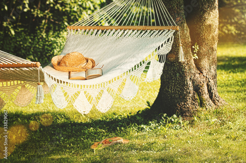 Fototapeta View of hammock and book  on a summer day