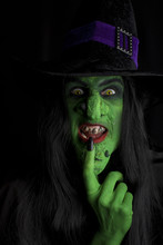 Evil Green Witch, Black Background.