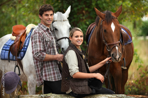 Fotografie, Tablou Young people horseriding