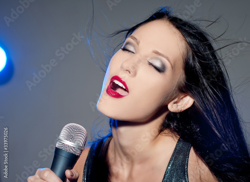 Photo  Woman with a microphone