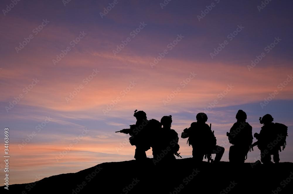 Fototapeta Silhouette of modern troops in Middle East silhouette