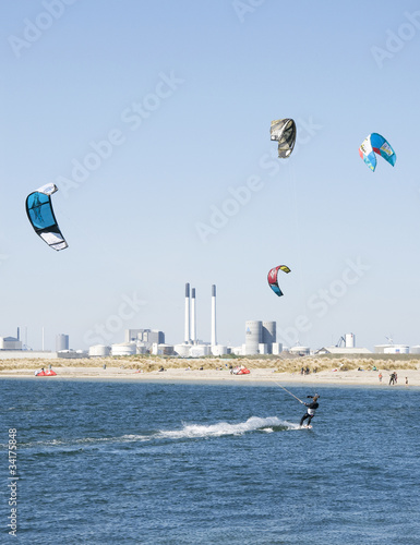 Photo  kitesurfers against an industrial background