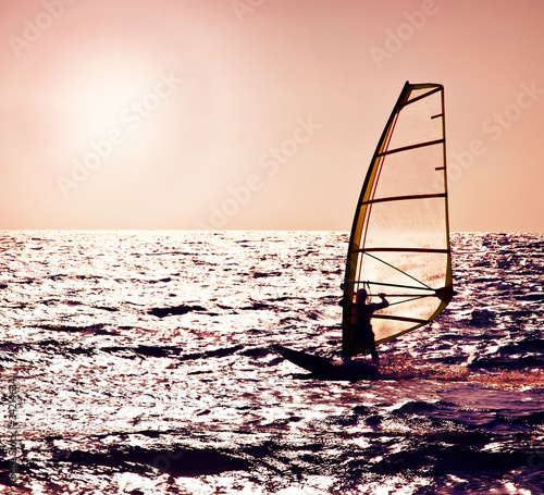 Foto-Leinwand - Windsurfer silhouette over sea sunset (von Anna Om)