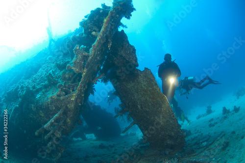 Photo Stands Shipwreck Divers exploring a large shipwreck