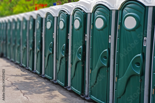 Valokuva  Row of porta potty outhouses ready for use
