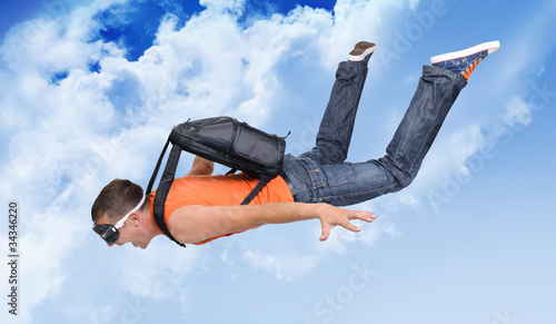 Canvas Prints Sky sports Extreme flight man with a parachute in the clouds