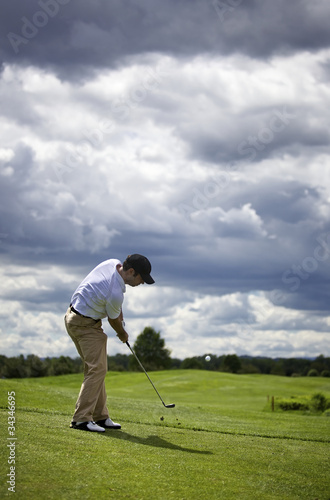 Fotografie, Obraz  Golf player pitching