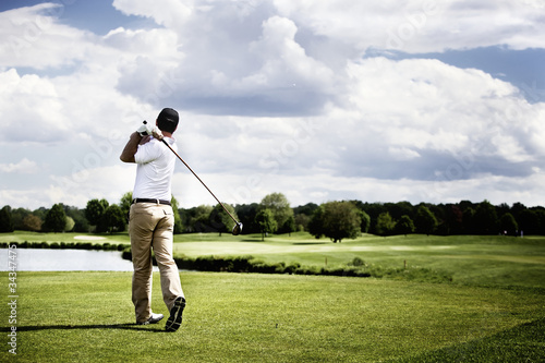 Spoed Foto op Canvas Golf Golf player teeing off