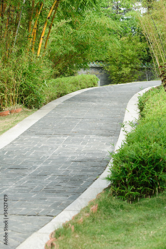 Poster Channel Stone walkway with bamboo in both side