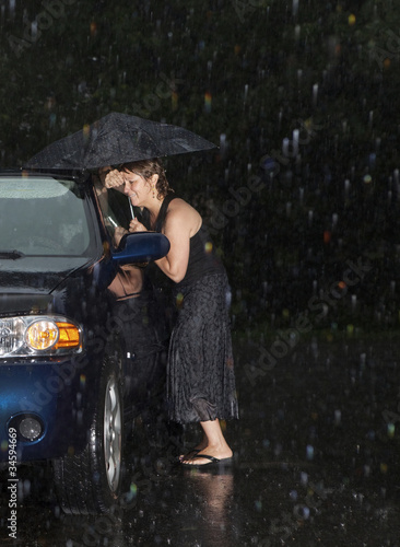 Fotografie, Tablou  Woman locked out of her car in the rain