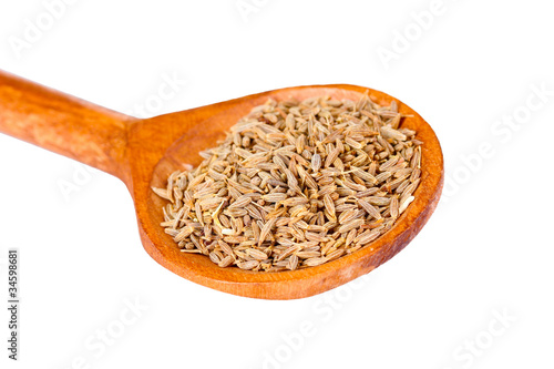 Spoed Foto op Canvas Kruiden 2 spice cumin in wooden spoon isolated on white